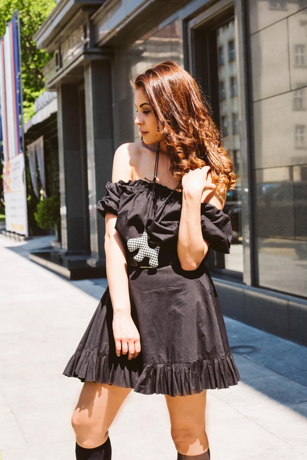 black dress, off shoulder. doggy necklace