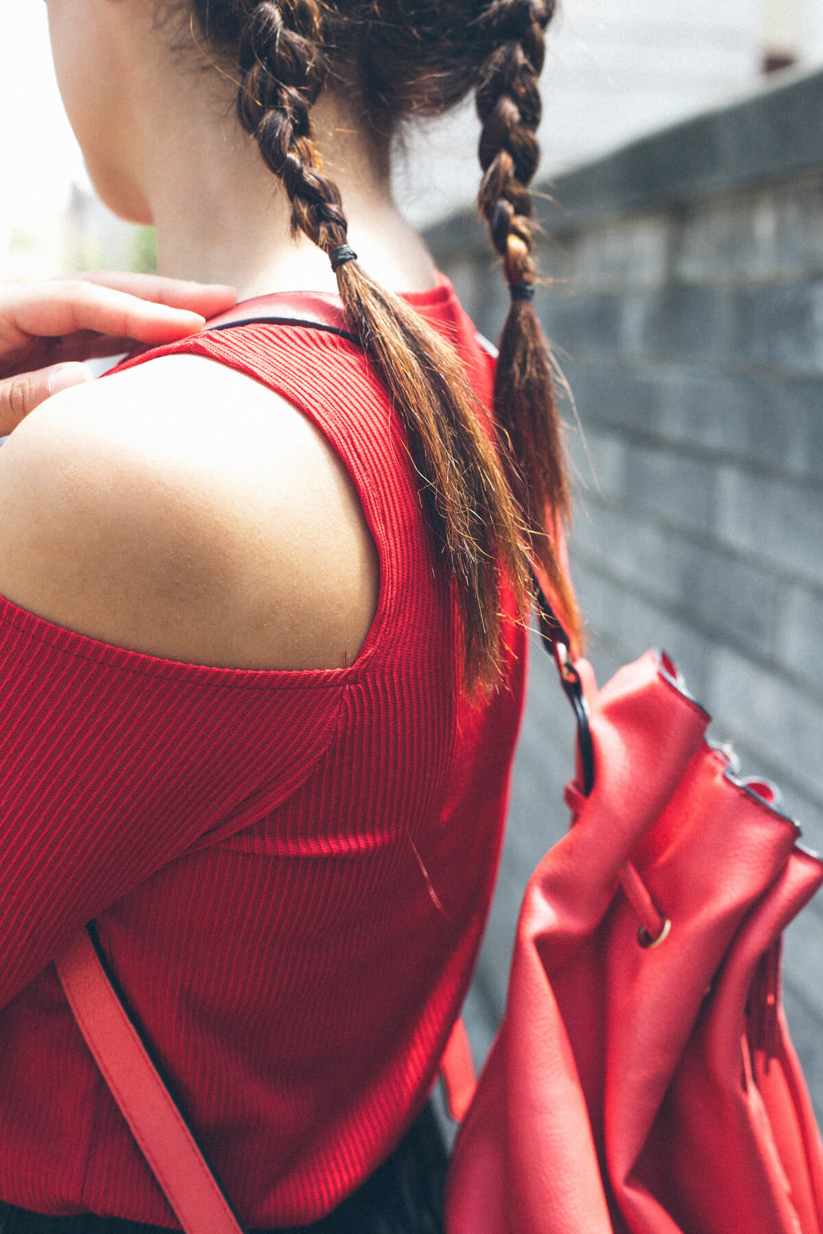red blouse and red backpack