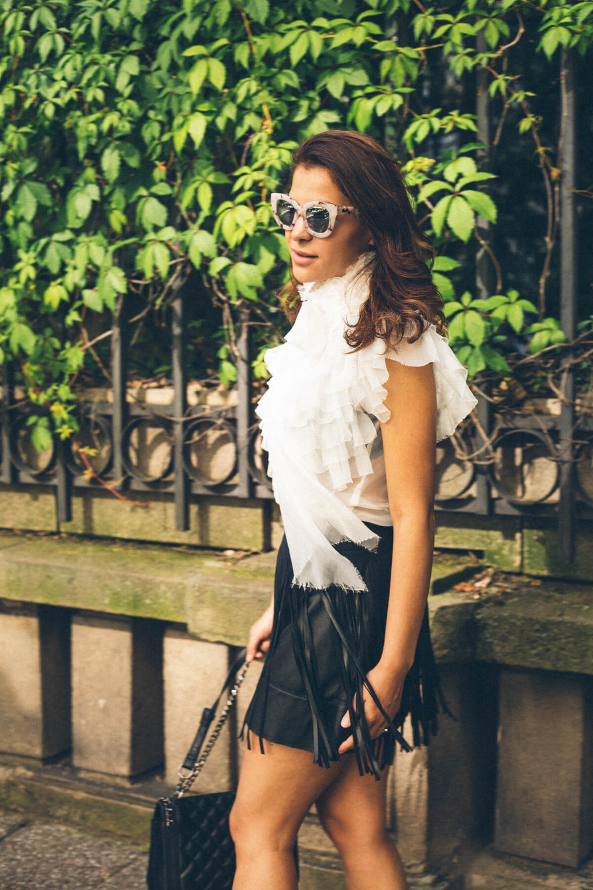 White shirt and black skirt outfit and sunglasses
